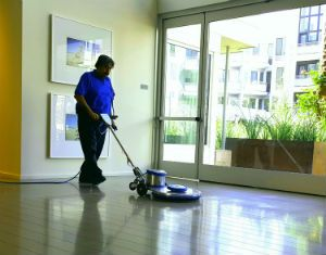 A man buffing a clean floor.
