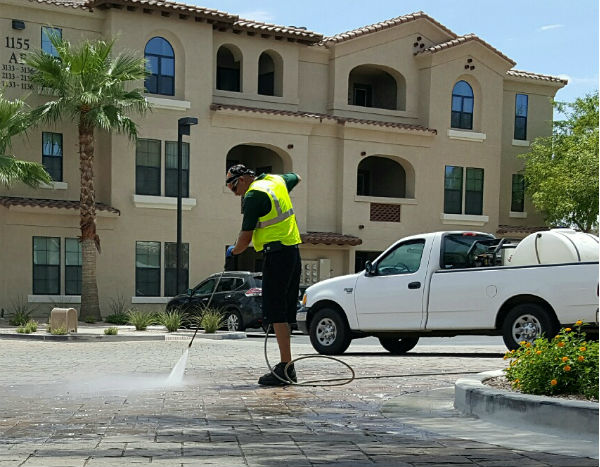 Pressure washing commercial complex